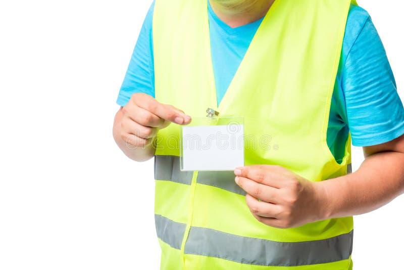 Förse med märke i händerna av en arbetare i waistcoat royaltyfri fotografi