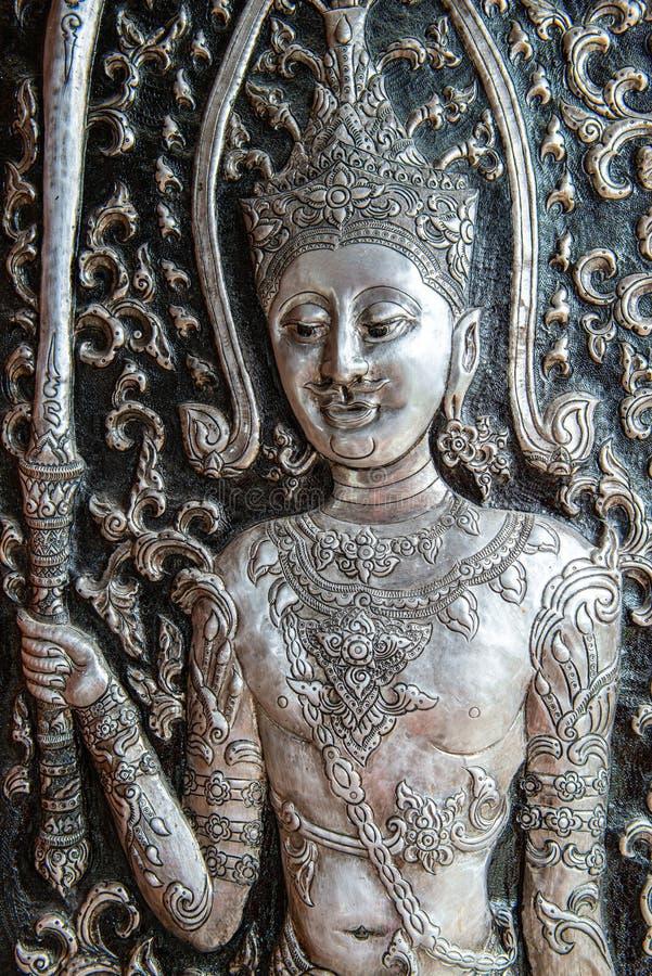 Försilvra att snida konst i templet royaltyfri bild