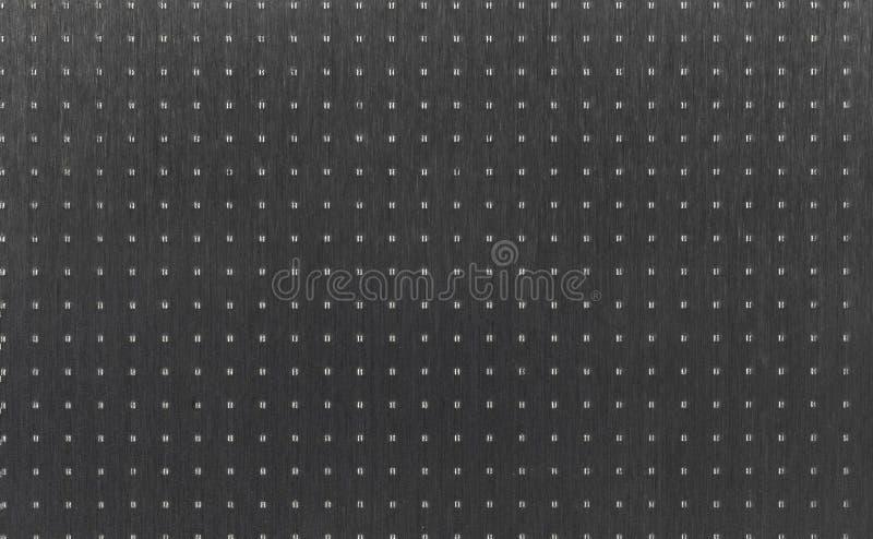 Försilvra metalltextur som stämplar fläckar arkivbilder