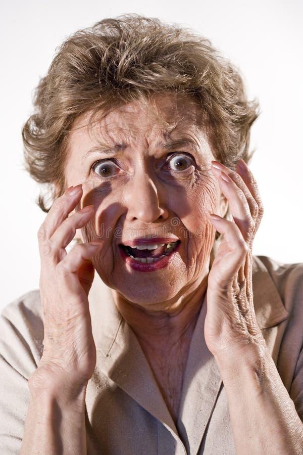 förskräckt kvinna för åldring royaltyfri fotografi