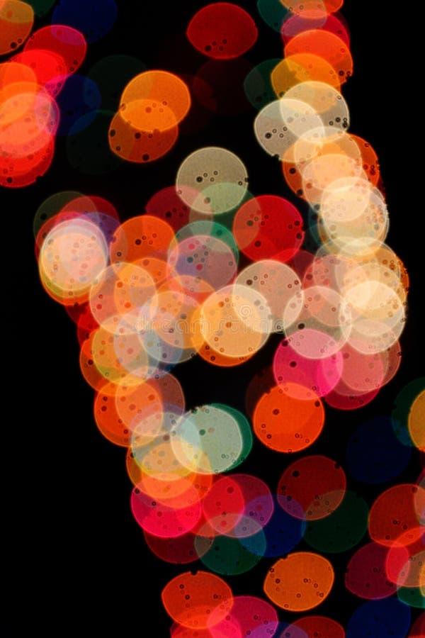 Förslag av lampor på natten royaltyfria foton