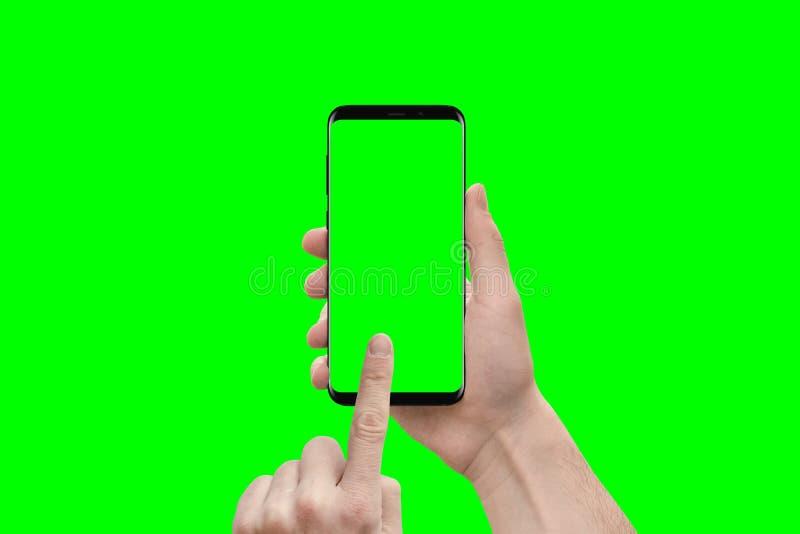 Första personsikt på moderna smarta telefonihhänder arkivbilder