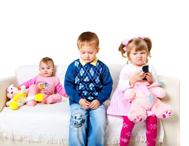 förtjusande ungar tre royaltyfri foto