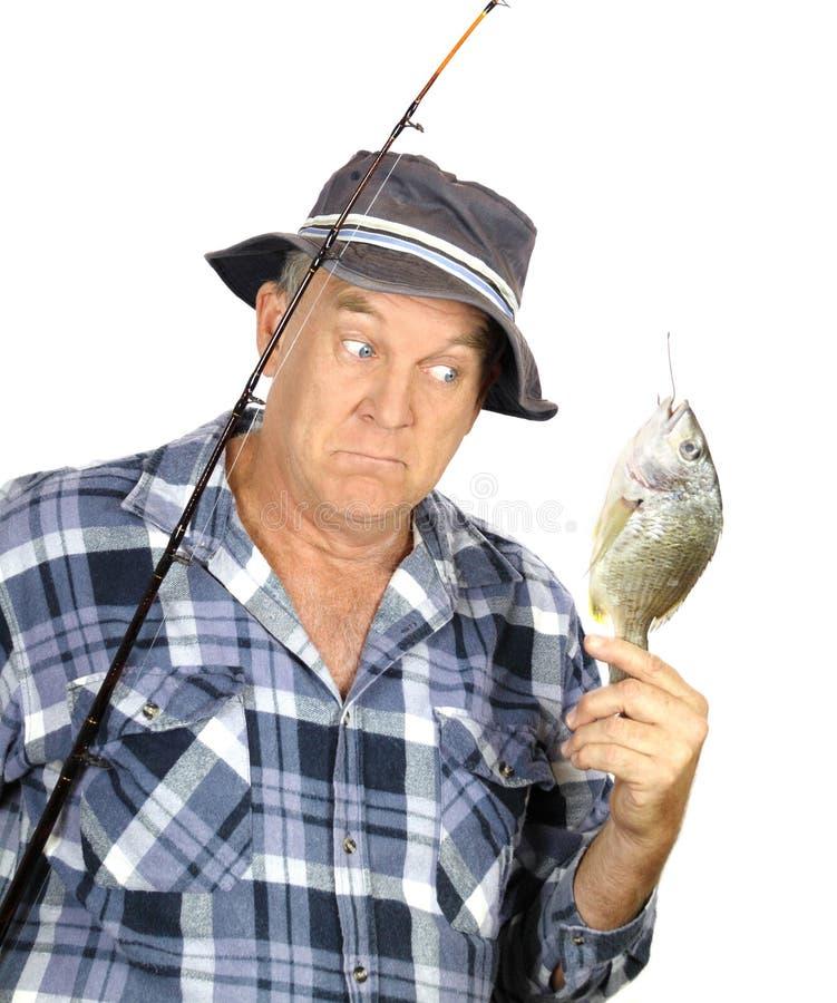 förvånad fiskare arkivfoton