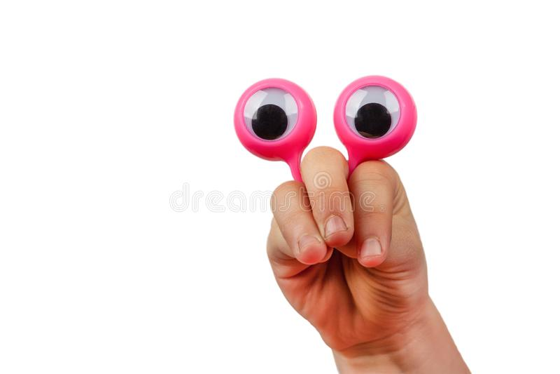 Förvånad framsida som göras med barnhanden och googly ögon arkivbild