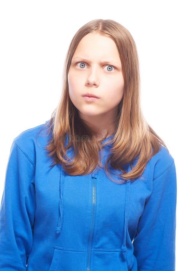 Förvånad ilsken tonårig flicka fotografering för bildbyråer