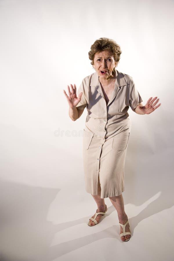 förvånad kvinna för åldring arkivfoton
