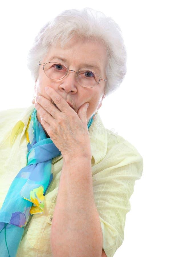 förvånad kvinna för pensionär arkivbild