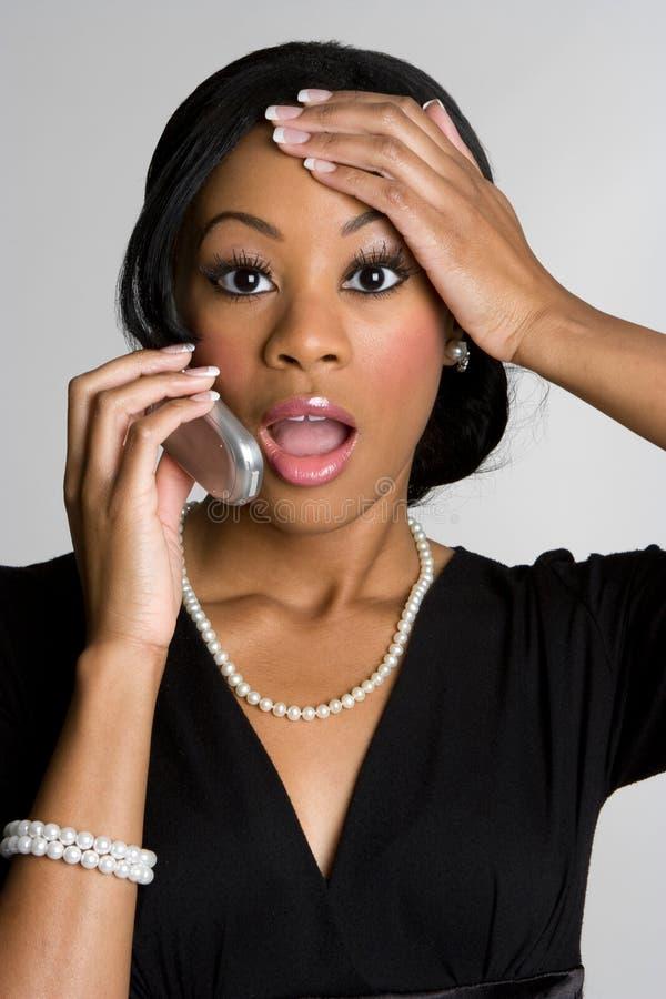 förvånad kvinna för telefon royaltyfria bilder