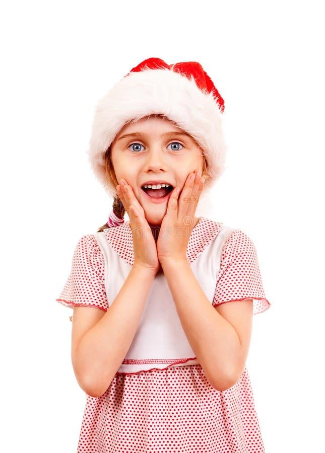 Förvånad liten flicka i Santa Hat fotografering för bildbyråer