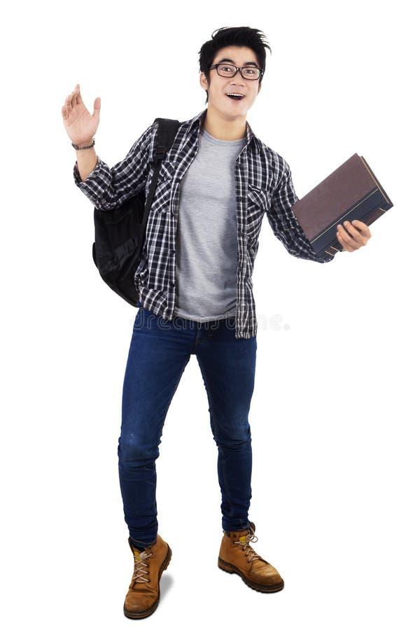 Förvånad manlig student arkivfoton