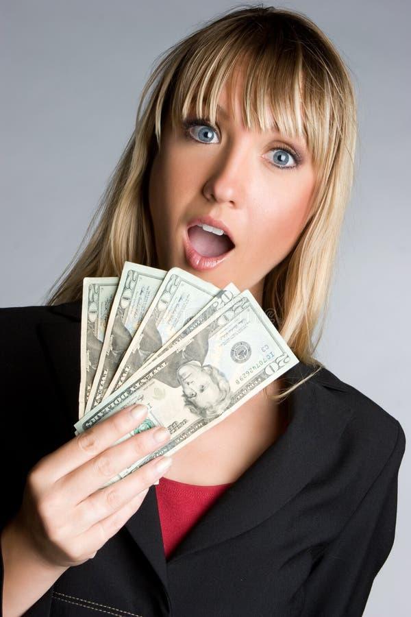 förvånade affärskvinnapengar royaltyfria bilder