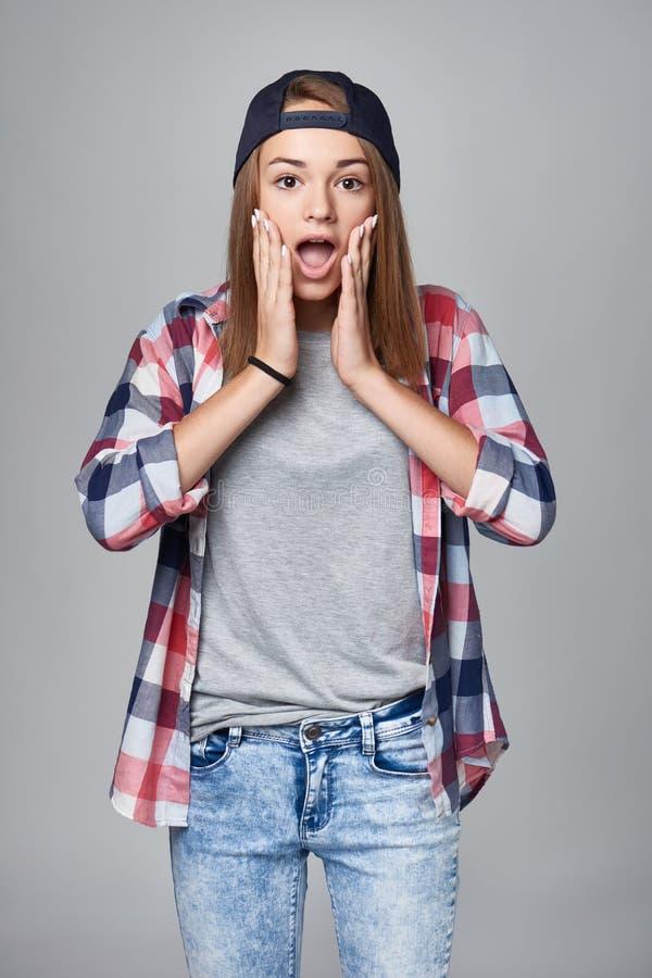 förvånadt teen för flicka arkivfoto