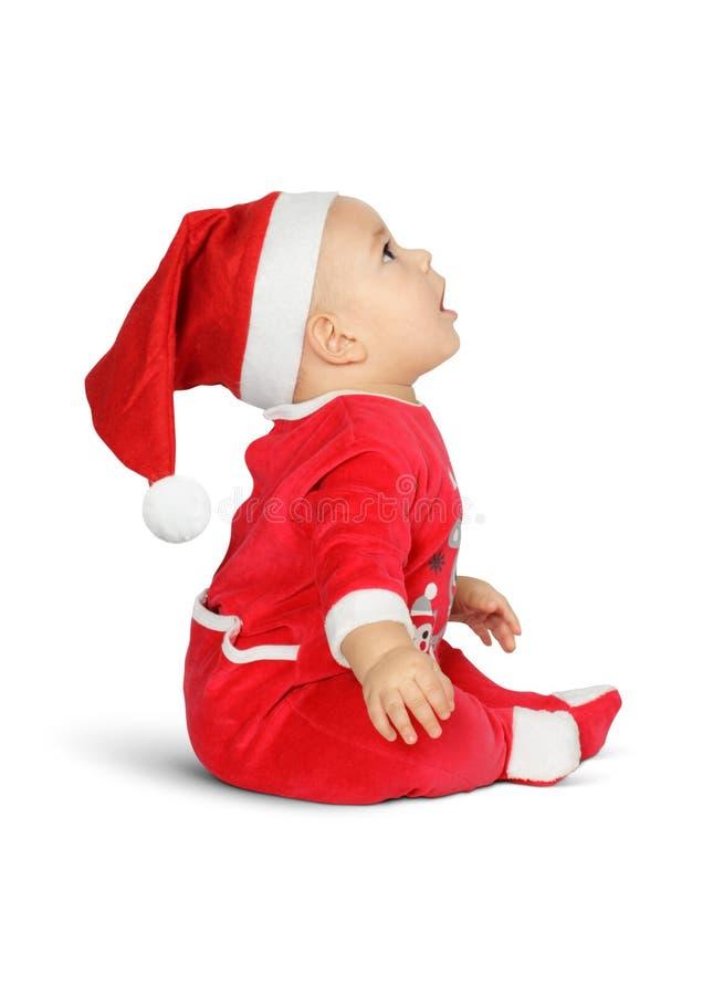 Förvånat behandla som ett barn lite Santa Claus isoleted på vitt, sidosikt arkivbild