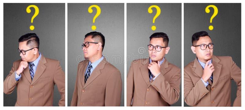 Förvirrad affärsman med fråga fotografering för bildbyråer