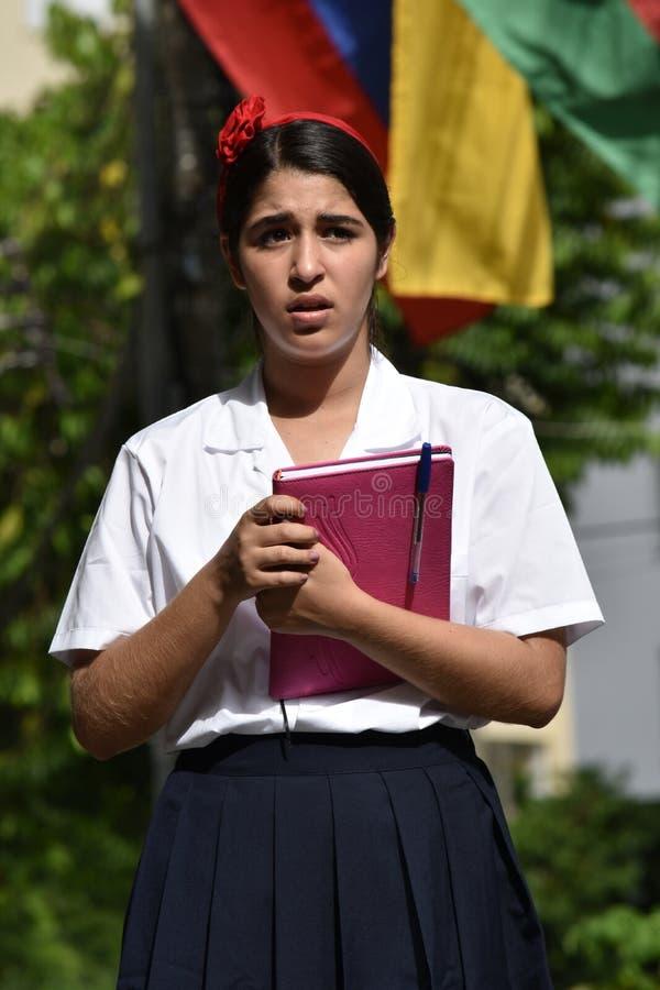 Förvirrad kvinnlig tonårig internationell student fotografering för bildbyråer