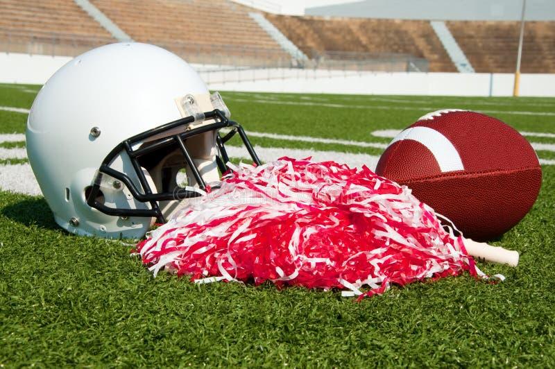 Fútbol americano, casco, y Pom Poms fotografía de archivo libre de regalías
