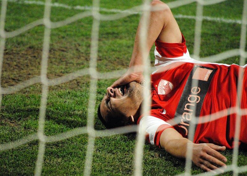 Fútbol o dolor de lesión del jugador de fútbol imágenes de archivo libres de regalías