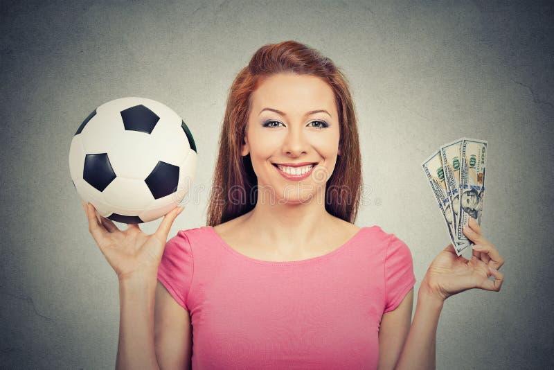 Fútbol y dinero imagenes de archivo