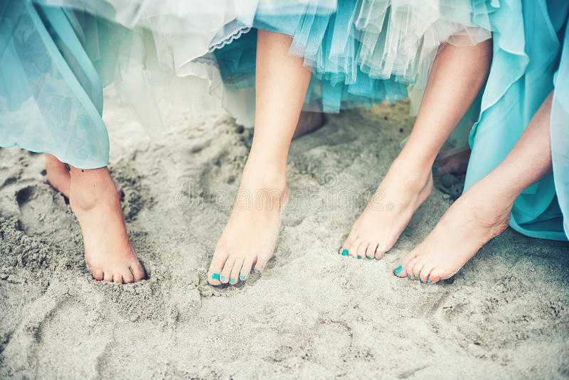 Füße im Sand stockbild