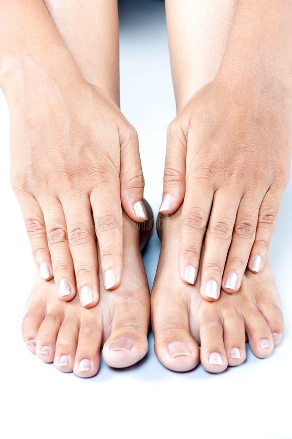 Füße und Hand lizenzfreie stockbilder