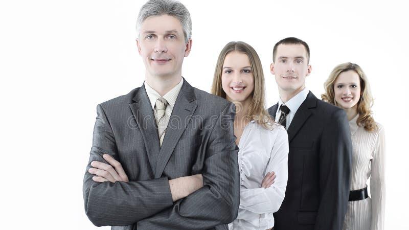 Führer, stehend vor dem Geschäftsteam lizenzfreie stockfotografie