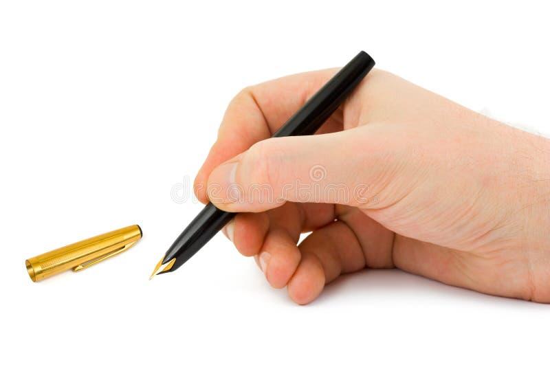 Füllfederhalter in der Hand stockbild