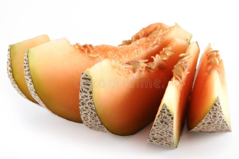 Fünf Stücke der orange Kantalupe lizenzfreie stockfotografie