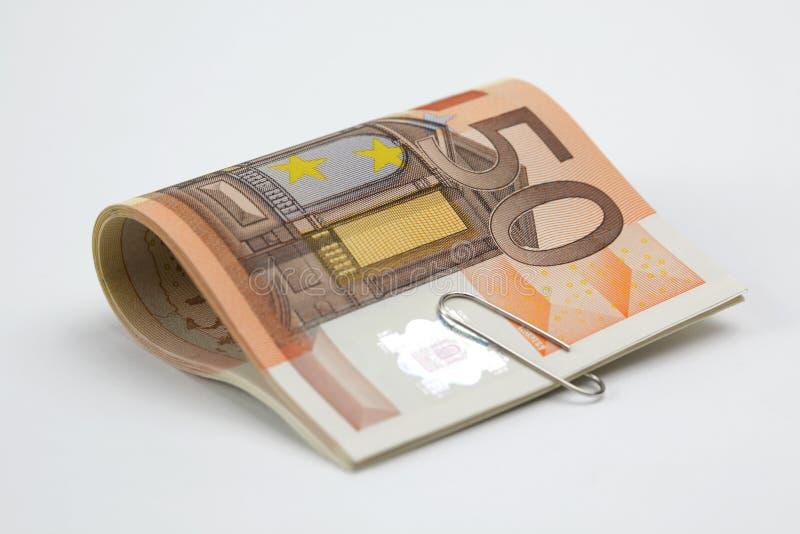 Fünfzig Eurorechnungen befestigt stockfoto