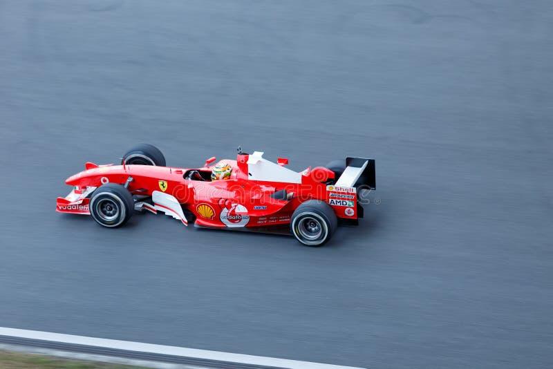 F1赛车在法拉利赛跑的天 库存图片