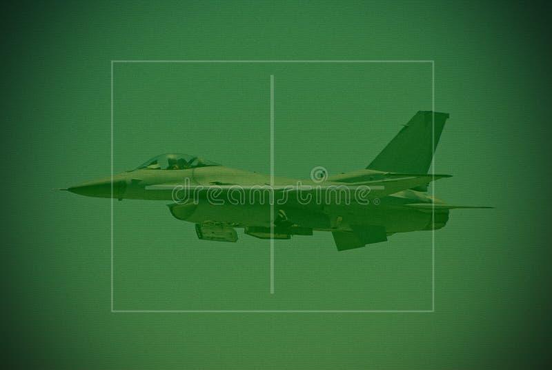 F-16 fighter jet seen through. Fighter jet in flight seen through night vision lens stock photos