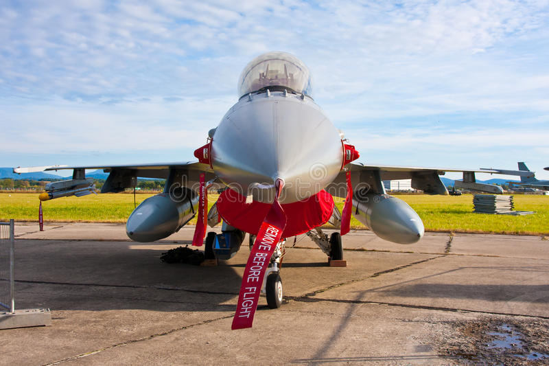 F-16 Jet Fighter. F-16 military jet fighter on the ground with safety bands royalty free stock photo