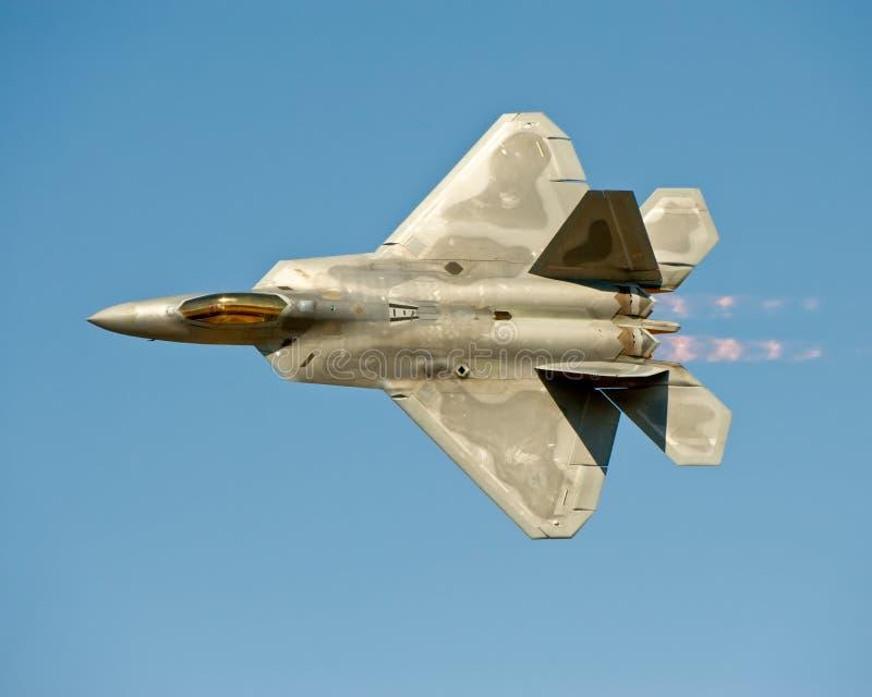 F-22 Raptor aircraft in flight. Lockheed Martin/Boeing F-22 Raptor American military fighter in flight, blue sky background stock photos