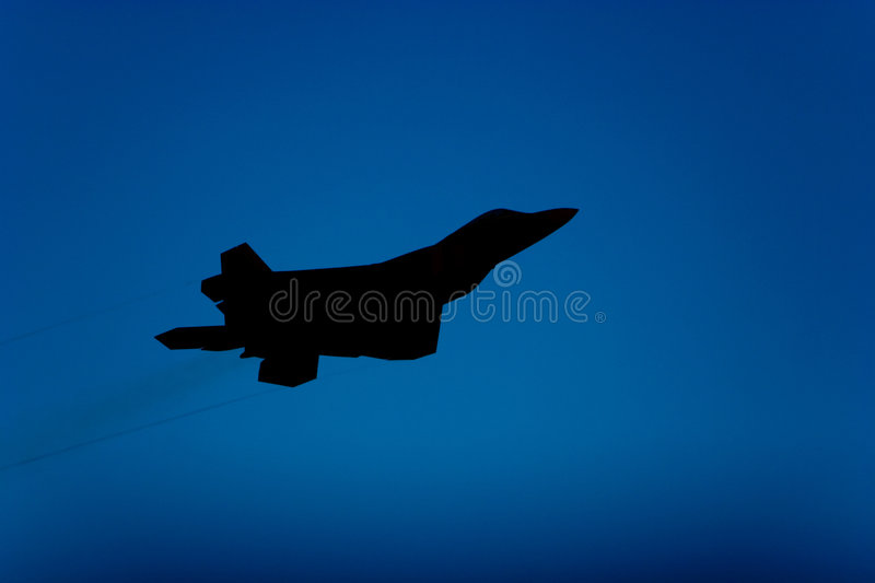 F-22 Raptor fighter jet silhouette. F-22 Raptor jet airplane silhouette during airshow royalty free stock images