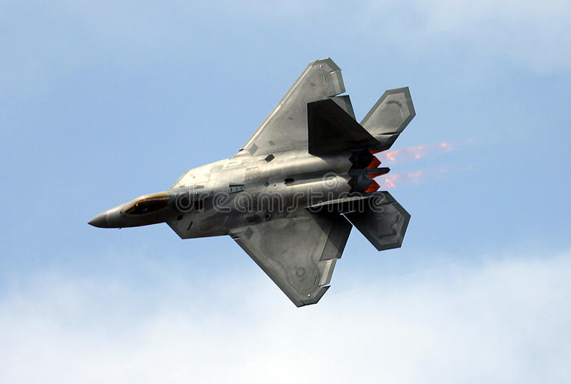 F-22 Raptor over Luke AFB. An Air Force F-22 Raptor performs a demonstration flight over the skies of Luke AFB located in Glendale, AZ during Luke Days 2011. The stock photography
