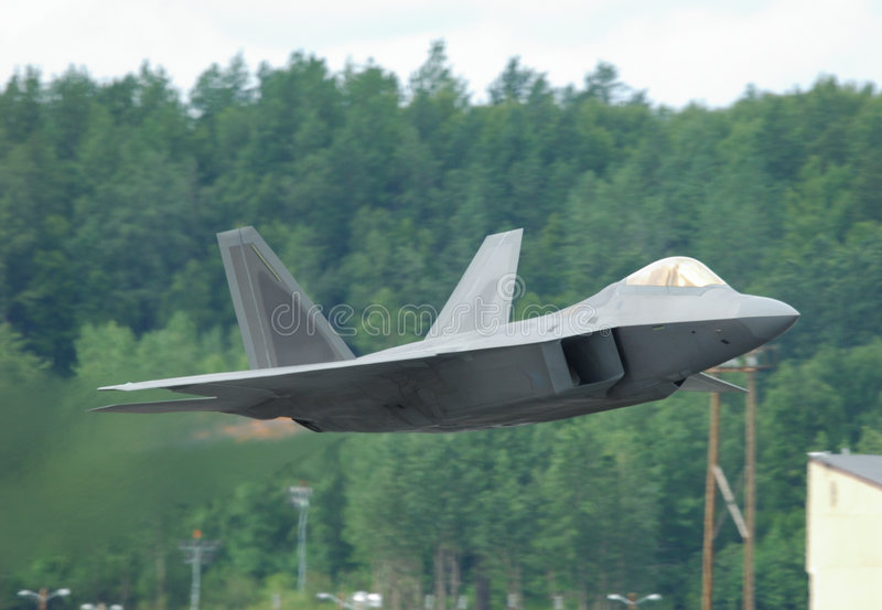 F-22 Raptor taking off. Stealth jet fighter F-22 Raptor taking off - Arctic Thunder airshow 2008 - Anchorage - Alaska - USA royalty free stock image