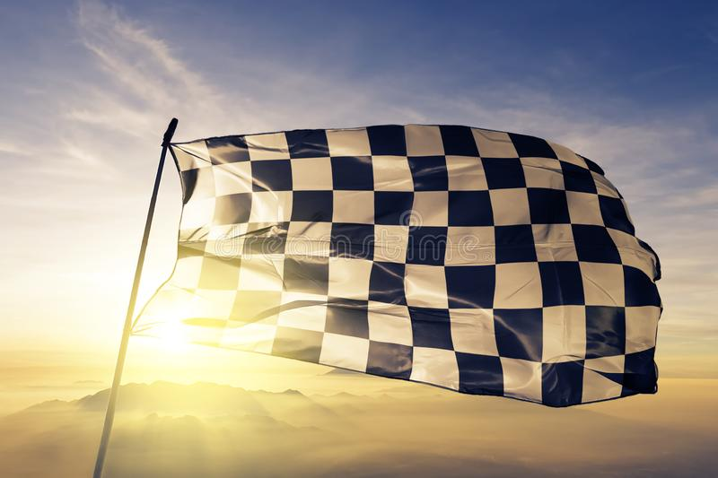 F1 chequered flag textile cloth fabric waving on the top sunrise mist fog royalty free illustration