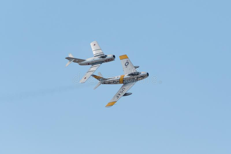 F-86F SABRE and Mikoyan-Gurevich MiG-15 royalty free stock image