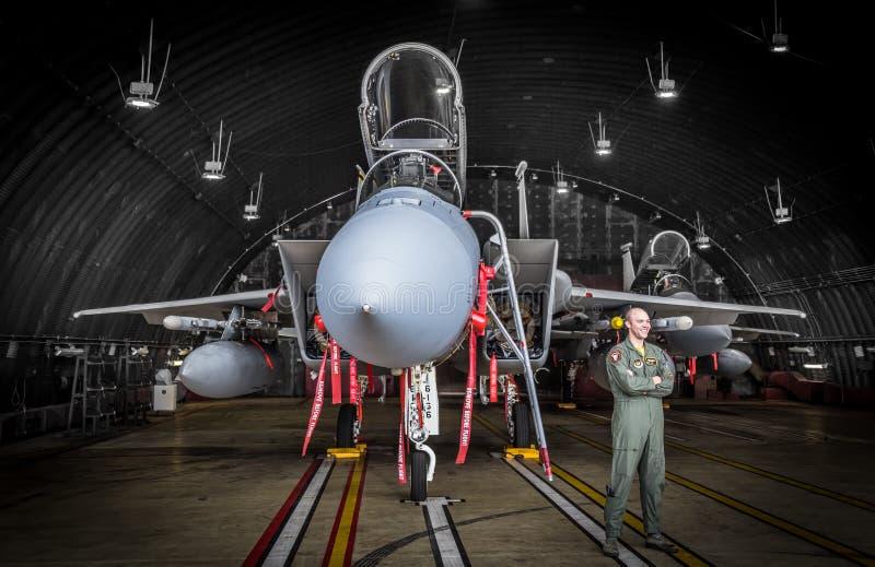 F15 fighter jet pilot in hangar stock image