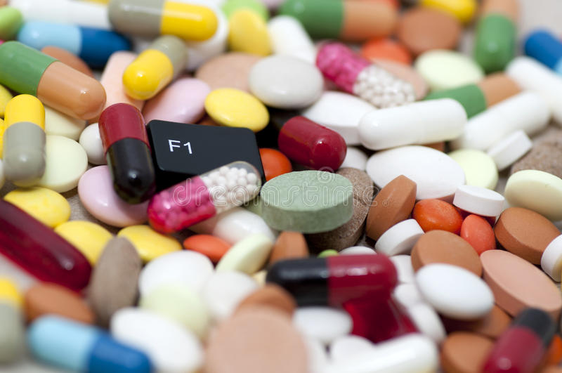 F1 (help) key among drugs (help with drugs) royalty free stock photo
