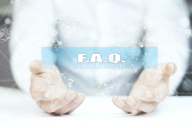 F.A.Q. text on screen and man hand.  royalty free stock photo
