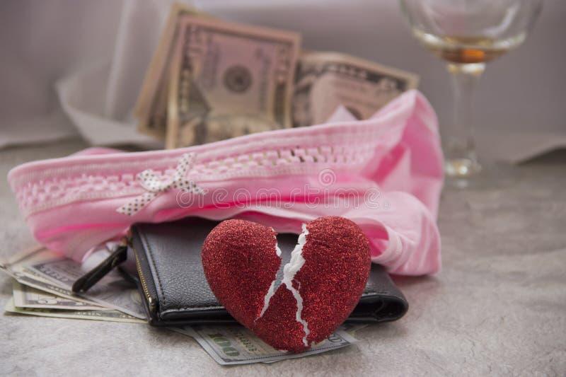 F?r?lskelse f?r pengar ?r prostitution royaltyfri bild