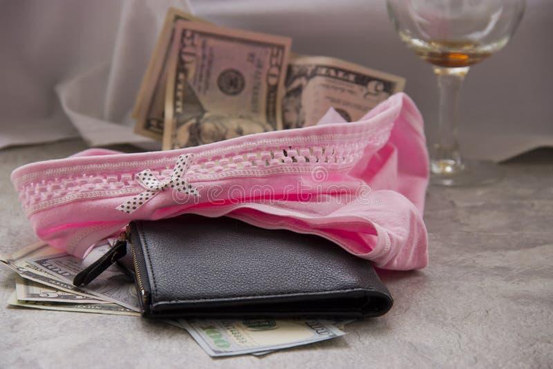 F?r?lskelse f?r pengar ?r prostitution royaltyfri fotografi