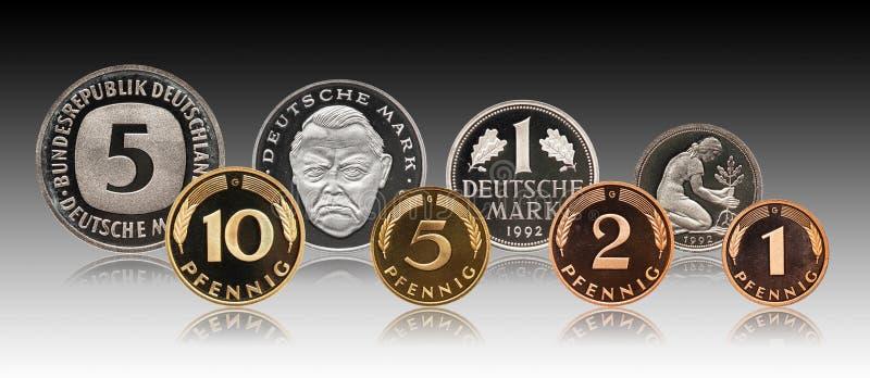 F?r pfennigfl?ck f?r Tyskland tysk upps?ttning f?r mynt, lutningbakgrund arkivbilder