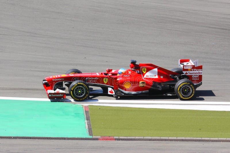 F1 Raceauto:  Ferrari-Bestuurder Fernando Alonso stock foto's