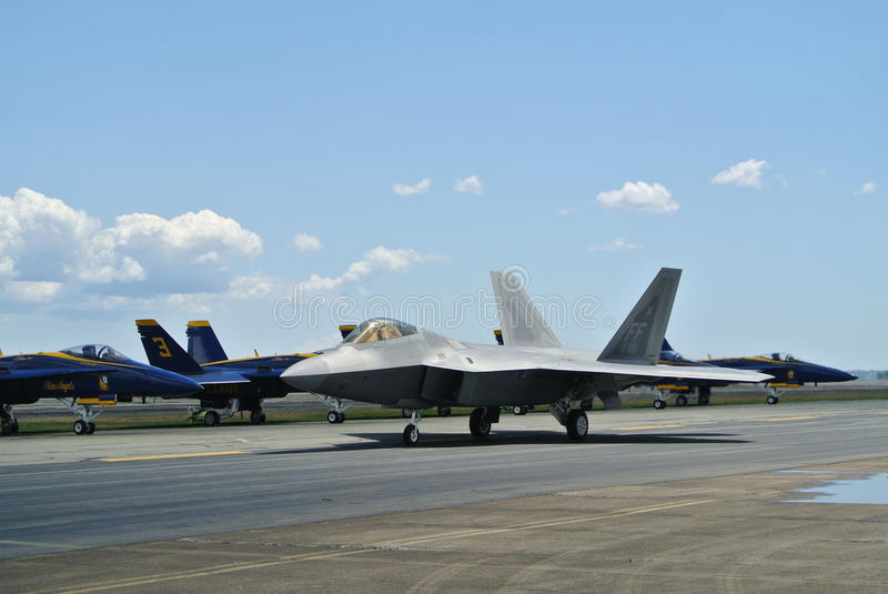 F22 Raptor and Blue Hornets Military Jets royalty free stock photos