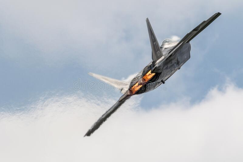 F-22 Raptor at the Rockford Airshow. A United States Air Force F-22 Raptor performs a demo at the 2015 Rockford Airfest stock photo