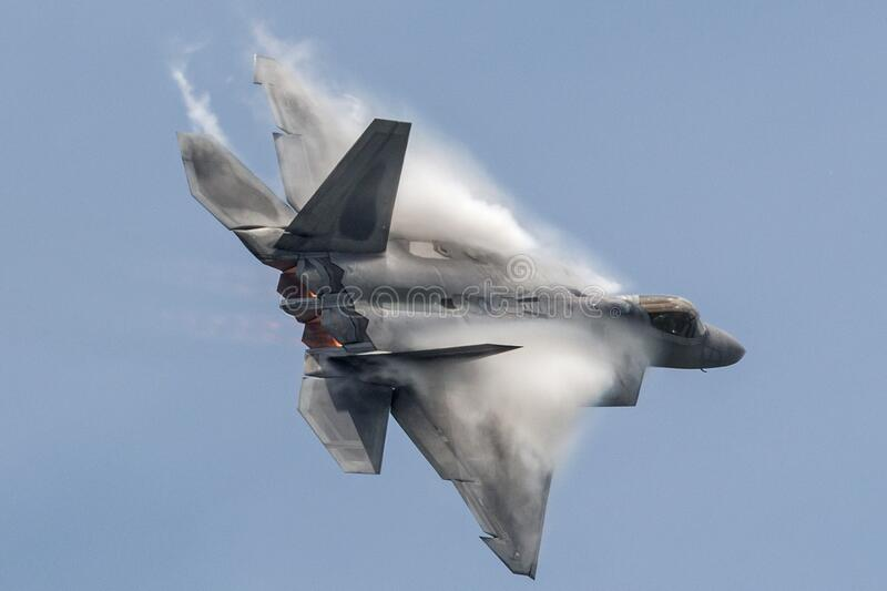 F-22 Raptor at the Rockford Airshow. A United States Air Force F-22 Raptor performs a demo at the 2015 Rockford Airfest stock images