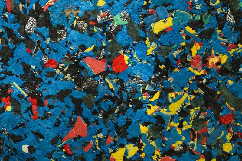 f?rgad abstrakt bakgrund Pressande textur av olika material royaltyfri bild