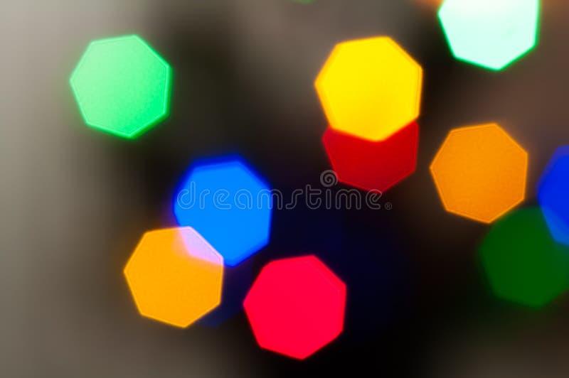 F?rgglade festliga m?ng--f?rgade cirklar Defocused abstrakt m?ngf?rgad bokeh t?nder bakgrund royaltyfri foto